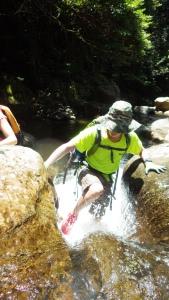 Phil climbing up the mini-waterfall