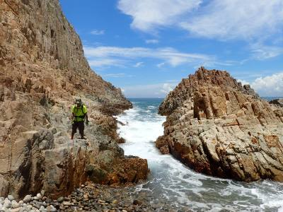 Phil walking along the coast